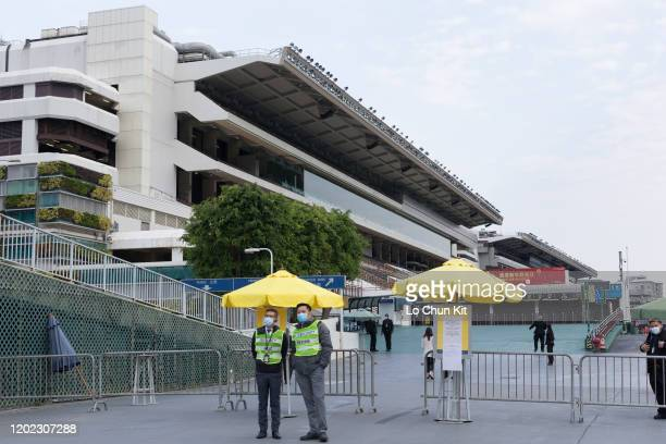 January 27 : Security guards at the public entrance of Sha Tin Racecourse during Chinese New Year Raceday 2020 on January 27, 2020 in Hong Kong....