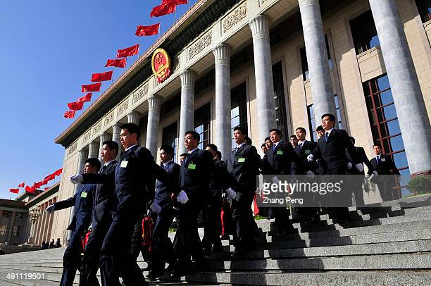 Security guards before the closing ceremony of the 2009 National People's Congress and Chinese People's Political Consultative Conference annual...