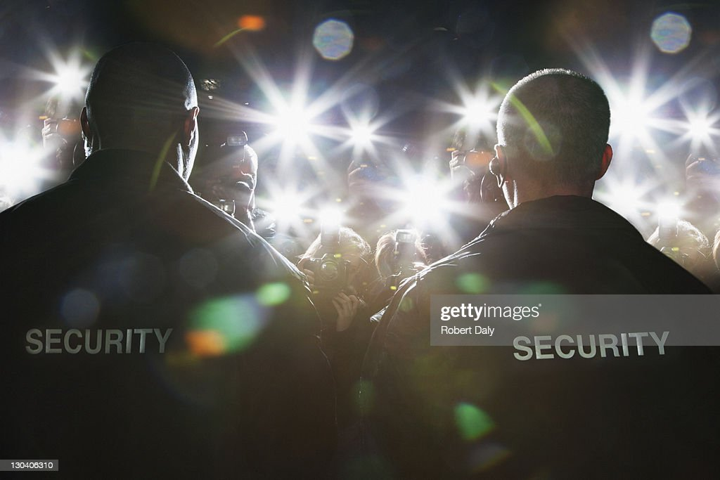 Security guards blocking paparazzi : Stock Photo
