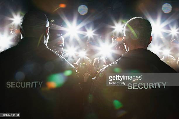 security guards blocking paparazzi - celebrities photos stock pictures, royalty-free photos & images