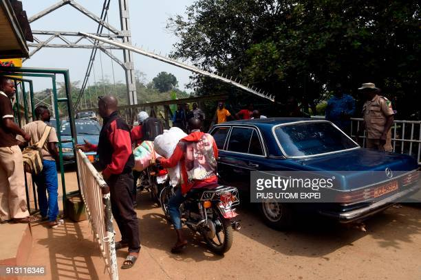 Security guards check vehicles leaving Nigeria for Cameroon at a checkpoint border between Cameroon and Nigeria in Mfum in Cross Rivers State...