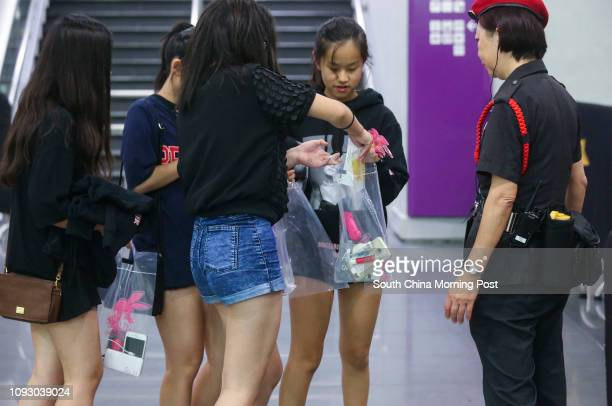 Security guards checking audiences' belonging for safety before entering the Ariana Grande live concert at the Asia World Expo in Chek Lap Kok...