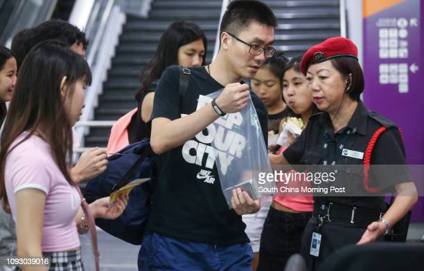 Security guards checking audiences' belonging for safetyy before entering the Ariana Grande live concert at the Asia World Expo in Chek Lap Kok...