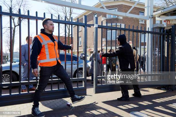 Security guards close a fence of The Hague market one of the largest market in Europe amid the worsening COVID19 virus pandemic on March 25 2020 in...