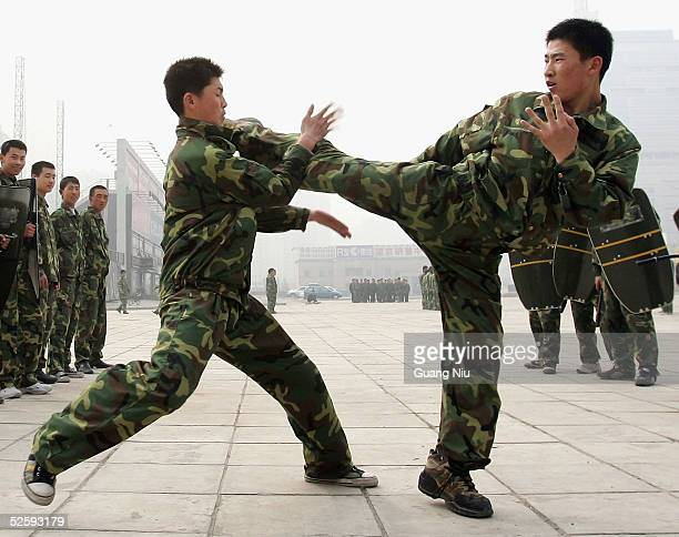 Security guards drill on April 6, 2005 in Beijing, China. More than 300 million Chinese will move from the countryside to cities by 2020, changing...
