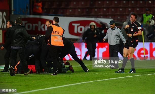 Security guards intervene to Trabzonspor fan after he attacked to referee during the Turkish Spor Toto Super Lig football match between Trabzonspor...