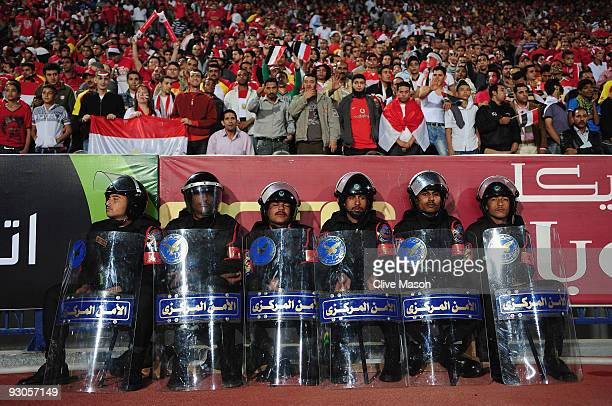Security guards look on during the FIFA2010 World Cup qualifying match between Egypt and Algeria at the Cairo International Stadium on November 14...