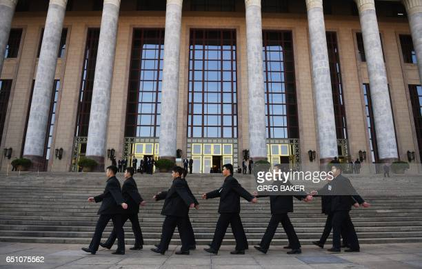 Security guards march before a plenary session of the Chinese People's Political Consultative Conference at the Great Hall of the People in Beijing...
