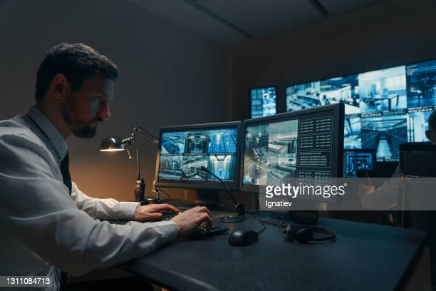 security guards monitoring modern cctv cameras indoors - business security camera stock pictures, royalty-free photos & images