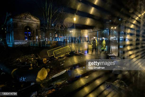 Security guards on duty at the protest late at night on February 4, 2021 in London, England. Earlier this week a High Court Judge told HS2's national...