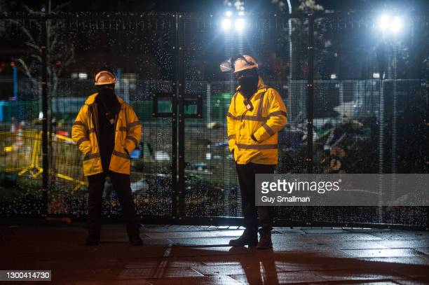 Security guards on duty at the protest late at night on February 5, 2021 in London, England. Earlier this week a High Court Judge told HS2's national...