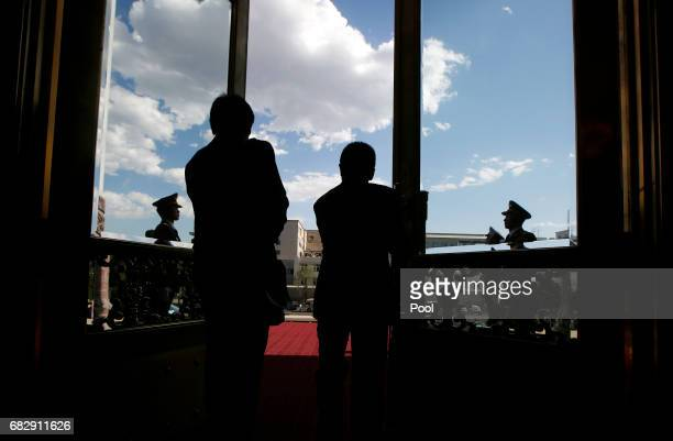 Security guards open the south gate of the Great Hall of the People before Russian President Vladimir Putin arrives to meet Chinese Premier Li...
