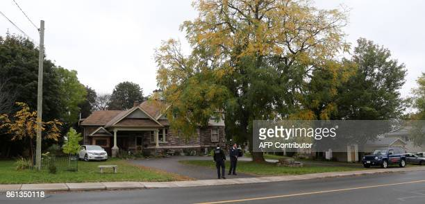 Security guards outside freed Canadian hostage Joshua Boyle's family home in Smiths Falls Ontario Canada on October 14 2017 Freed Canadian hostage...