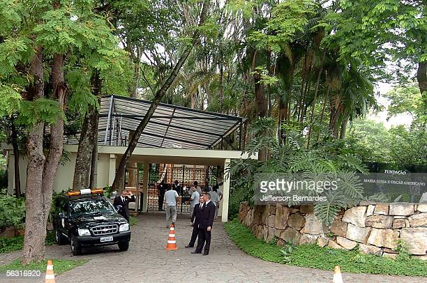 Security guards patrol outside of the grounds of the Maria Luisa and Oscar Americano Foundation as workers prepare the building for the wedding of...