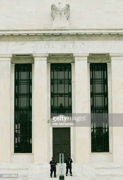 Security guards patrol outside the US Federal Reserve building August 9 2005 in Washington DC The Federal Reserve is expected to raise shortterm...