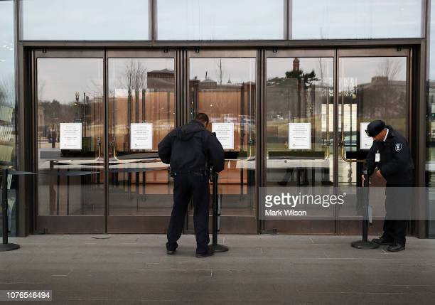 Security guards secure the doors of The National Museum of African American History that is closed due to the partial shutdown of the US government...