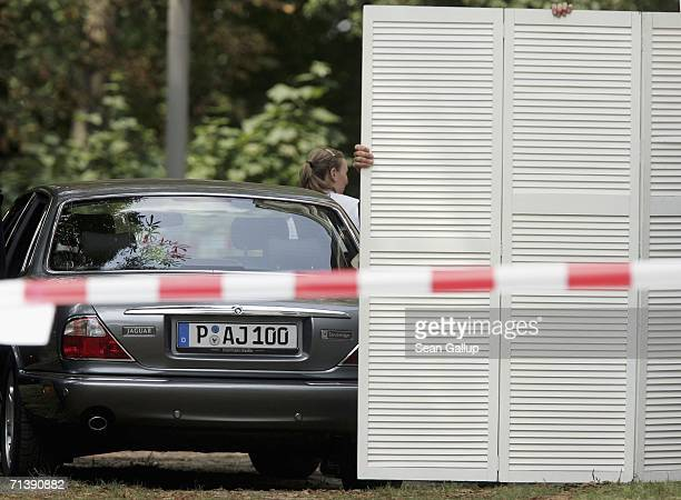 Security guards shield the wedding of German TV host Guenther Jauch on July 7 2006 in Potsdam Germany
