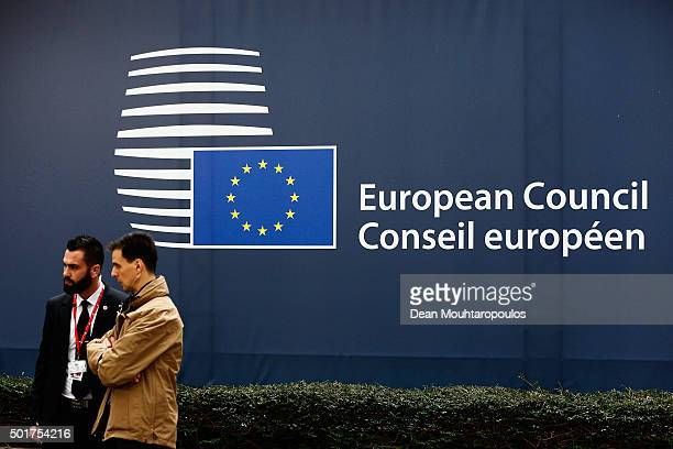 Security guards speak during The European Council Meeting In Brussels held at the Justus Lipsius Building on December 17 2015 in Brussels Belgium...