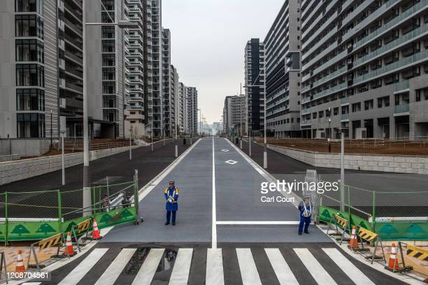 Security guards stand at an entrance to the Tokyo 2020 Olympics Athletes Village on March 31, 2020 in Tokyo, Japan. The Athletes Village, designed to...