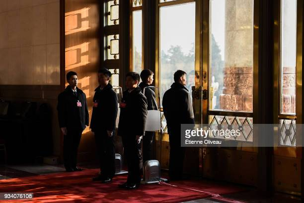 Security guards stand guard inside the Great Hall of the People before the seventh plenary session of the 13th National People's Congress on March...