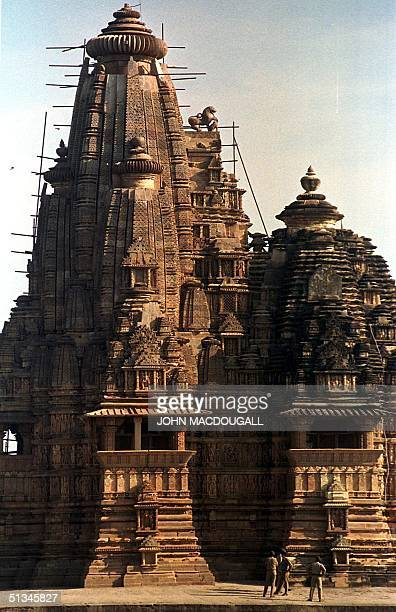 Security guards stand near the Vishnavatha temple one of the many temples forming the Khajuraho temples complex as preparations are under way for the...
