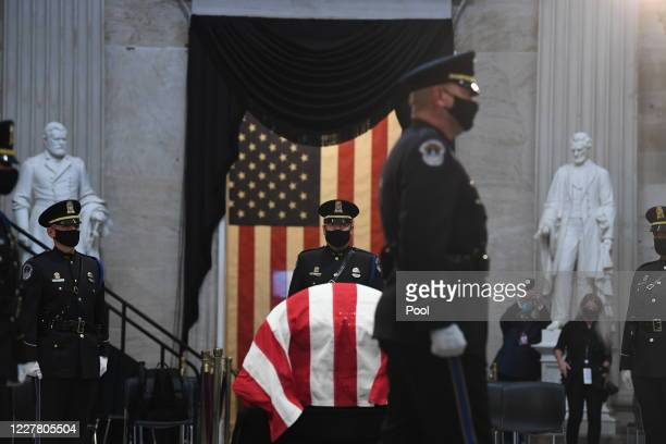 Security guards stand next to the casket during a memorial service for former Rep. John Lewis in the Capitol Rotunda on July 27, 2020 in Washington,...