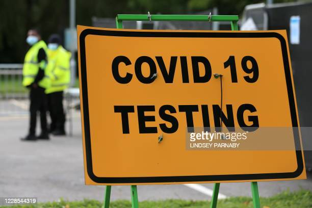 Security guards stand on duty at a novel coronavirus COVID-19 testing centre in Stockport, northwest England on September 16, 2020. - The British...