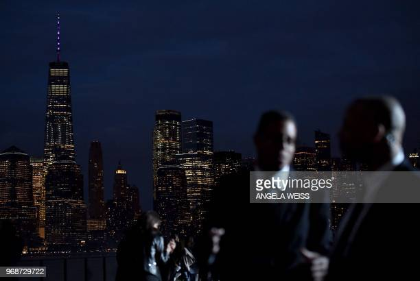 Security guards stand on the runway in front of the Manhattan skyline before the Saint Laurent Men's Spring/Summer 2019 collection during a runway...