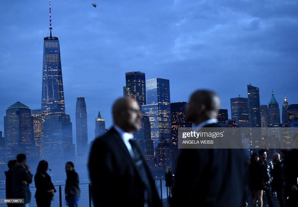 TOPSHOT - Security guards stand on the runway in front of the Manhattan skyline before the Saint Laurent Men's Spring/Summer 2019 collection during a runway show in Liberty State Park on June 6, 2018 in Jersey City, New Jersey.