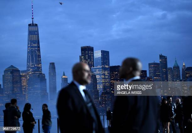 TOPSHOT Security guards stand on the runway in front of the Manhattan skyline before the Saint Laurent Men's Spring/Summer 2019 collection during a...