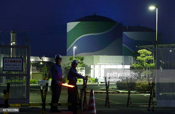 Security guards stand outside the entrance to Kyushu Electric Power Co's Sendai Nuclear Power Plant at night in Satsumasendai Kagoshima Prefecture...