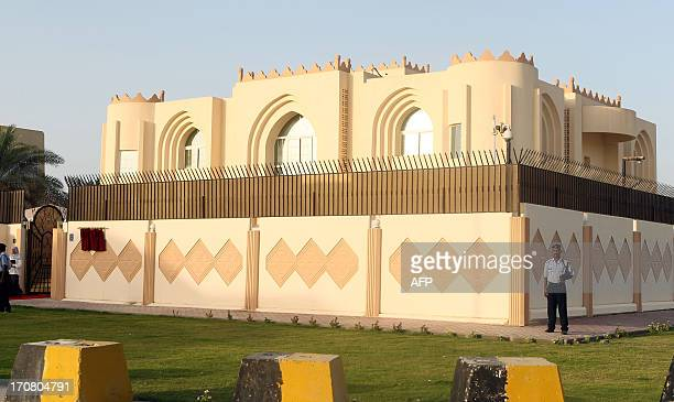 Security guards stand outside the new Taliban political office in Doha before the official opening on June 18 2013 The office is intended to open...