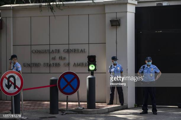 Security guards stand outside the U.S. Consulate General Chengdu in Chengdu, China, on Sunday, July 26, 2020. Theclosureof the U.S. Consulate in...