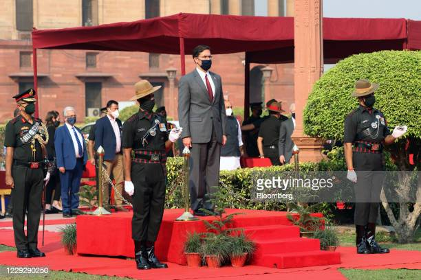 Security guards surround Mark Esper, U.S. Secretary of defense, during a ceremonial reception at the South Block lawns in New Delhi, India, on...