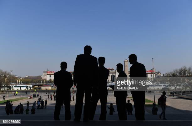 Security guards wait before a plenary session of the Chinese People's Political Consultative Conference at the Great Hall of the People in Beijing on...