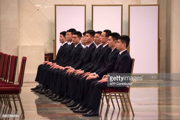 CORRECTION Security guards wait during the Chinese People's Political Consultative Conference plenary session at the Great Hall of the People in...