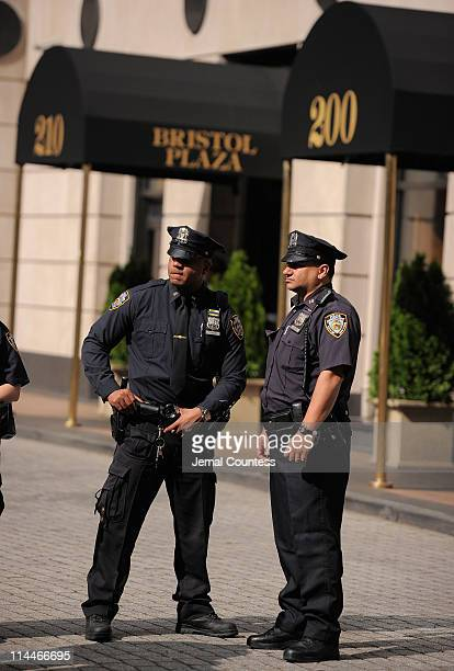Security guards wait outside the purported apartment where Dominique Strauss-Kahn will be under house arrest after he is released on bail from Rikers...