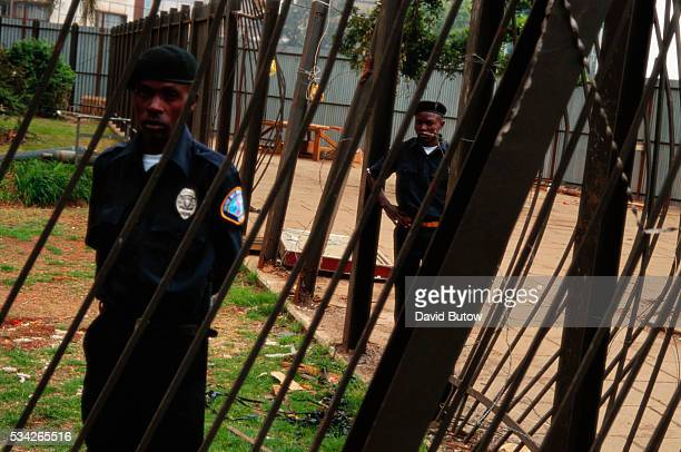 Security guards watching over the remains of the United States embassy after the bombing