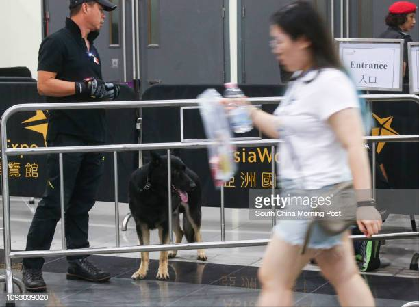 Security guards with sniffer dog on duty for safety before entering the Ariana Grande live concert at the Asia World Expo in Chek Lap Kok 21SEP17...