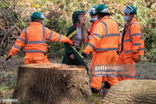 Security guards working on behalf of HS2 Ltd block an environmental activist objecting to the felling of trees in Denham Country Park for works...