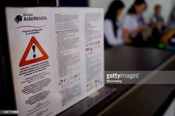 A security guideline is displayed at a Grupo Aeromexico SAB ticket counter at the Comalapa International Airport in Comalapa El Salvador on Tuesday...