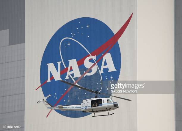 A NASA security helicopter flies past the Vehicle Assembly Building on launch day at the Kennedy Space Center in Florida on May 26 2020 A new era in...
