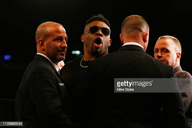 Security holds back Jarrell Miller during a faceoff with Anthony Joshua at a Press Conference at Madison Square Garden on February 19 2019 in New...