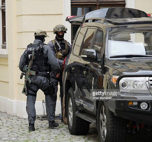 Security is on high alert as armed Police arrive at the Hotel Taschenbergpalais during the Bilderberg conference on Saturday afternoon June 11 2016...