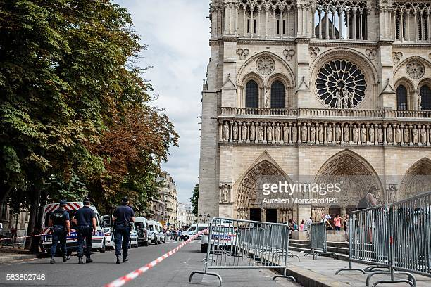Security is reinforced on the forecourt of the Notre Dame de Paris during the Mass chaired by Cardinal Andre Vingt Trois archbishop of Paris in...
