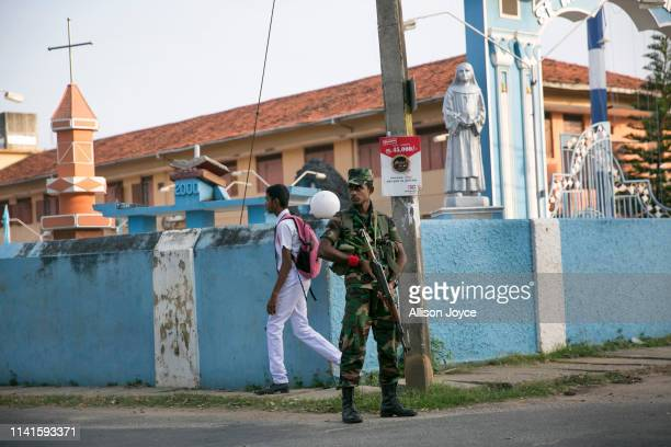 Security is seen as students return to school as schools reopen across the country after the Easter attacks on May 6 2019 in Batticaloa Sri Lanka 253...