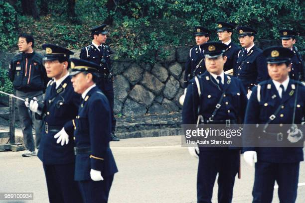 Security is tightened as Emperor Akihito and Empress Michiko visit the Mausoleum of Emperor Komei to report Emperor Akihito's enthronement at Omiya...