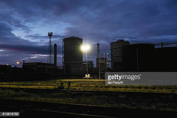 A security light shines down inside the closed SSI steel making site on September 27 2016 in Redcar United Kingdom One year on since the SSI steel...