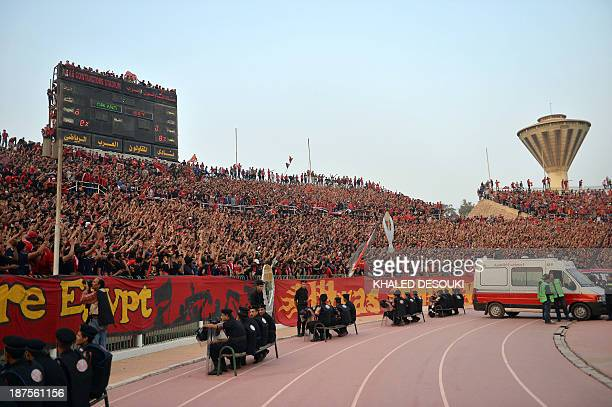 Security looks on as AlAhly fans gather prior to their African Champions League second leg final Egypt's AlAhly versus South Africa's Orlando Pirates...