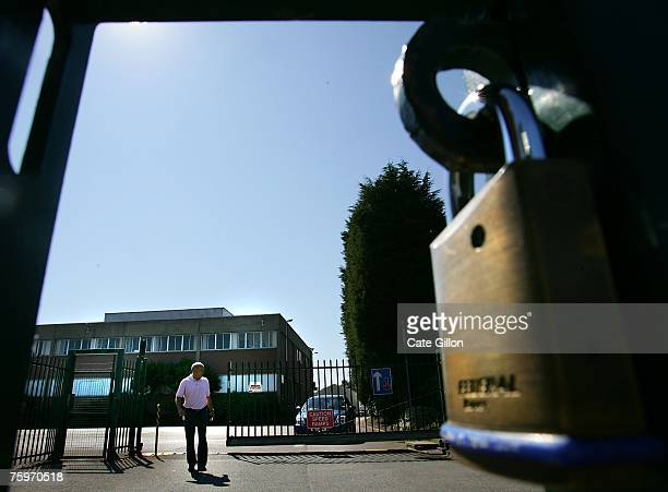 A security man allows a car to leave Merial the company that produces the foot and mouth vaccine situated by the Institute for Animal Health...